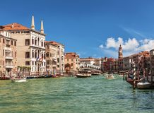 View of the Grand Canal, boats with tourists and the Rialto Bridge. Venice Royalty Free Stock Image