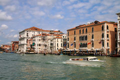 View of Grand Canal with houses and motorboats in Venice, Italy Stock Photo