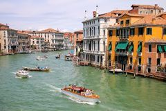 View of Grand Canal with houses and motorboats in Venice, Italy Stock Image