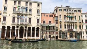 A view of a Grand Canal, old houses, motorboats in Venice, Italy stock footage