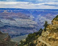 Hazy day at the Grand Canyon. View of the Grand Canyon with a hazy background and hikers in the fore ground stock photography