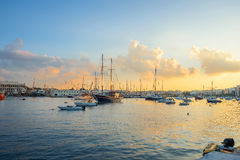 View of Grand Harbour at sunset. Valletta, Malta. Seascape with yachts in Grand Harbour at sunset. Valletta, Malta Royalty Free Stock Image