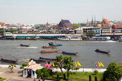 View of the Grand Palace in Bangkok. A view across the Grand Palace in Bangkok, with the Chao Praya River in the foreground Stock Photos