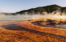 View of the Grand Prismatic Spring  at Yellowstone national park,WY,USA. Grand Prismatic Spring at Yellowstone national park,white steam,reflection,mountains Royalty Free Stock Photos