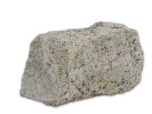 Granite rock isolated on the white background. View at granite magmatic rock isolated on the white background stock photos