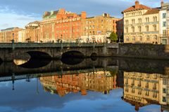 View of Grattan Bridge in Dublin, Ireland, with building reflections in the Liffey river royalty free stock photography