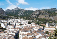 View of Grazalema. Aerial view of Grazalema is located in the Spanish province of Cadiz, a typical rural village of white houses with mountains in the background Royalty Free Stock Photos