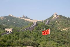 View of the Great Wall of China and the Chinese flag. royalty free stock photos