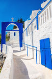 A view of a Greek church with iconic blue and white stairs again. St clear blue sky on Greek island, Kalymnos, Greece Royalty Free Stock Photography