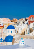 View of the Greek city of Oia with a miniature souvenir house Royalty Free Stock Images