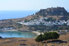 View of the greek Rhodes Islands Old Lindos Town, blue sky, bright colour, white little houses in the hill. View of the greek Rhodes Island Old Lindos Town, blue Royalty Free Stock Photos