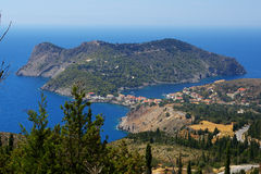 View on Greek village Assos. View on the beautiful Greek village Assos, with trees and pine tree in front - Kefalonia Greece Royalty Free Stock Photo