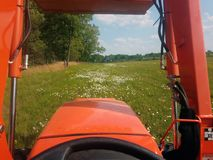 View of field of flowers from tractor stock images