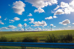 View of green field with Windmills background.JPG Stock Photography