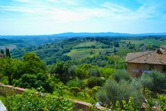 View of the green fields of the countryside of Tuscany from a lo. Okout in San Gimignano, Italy royalty free stock photos