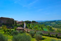 View of the green fields of the countryside of Tuscany from a lo. Okout in San Gimignano, Italy royalty free stock photography