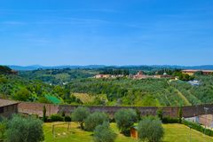 View of the green fields of the countryside of Tuscany from a lo. Okout in San Gimignano, Italy royalty free stock photo
