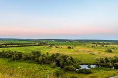View of green forest-steppe plain. River Koren Root valley, typical landscape of Belgorod region, Russia. Evening time Stock Photo