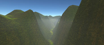 View of green gorge with high hills. The daytime with a blue sky and fog Stock Photography
