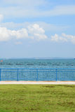 View Of Green Grass, Sea And Blue Sky Stock Photography