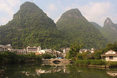 View with Green Hills and Bridge in Yangshuo Stock Image