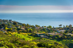View of green hills and houses overlooking the Pacific Ocean  Royalty Free Stock Images