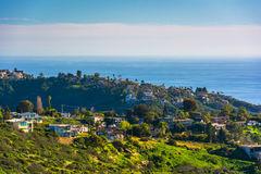 View of green hills and houses overlooking the Pacific Ocean  Stock Images