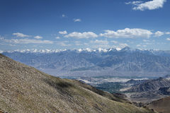 View of green leh valley and majestic mountain range Stock Photo