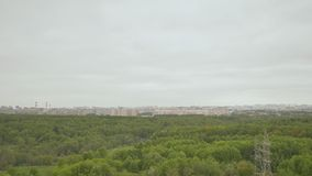 View of the green massif from the height of the building on the outskirts of Moscow. May. Spring. stock video footage
