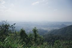 View of green mountain under mist and sky cloudy , Umphang Tak Thailand.  stock photos