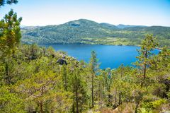 View on green mountains covered with forest and lake from hiking way to Preikestolen, Stavanger region, Norway stock image