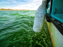 View of Green Ocean Waves from Boat Board Royalty Free Stock Photos