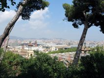 View from green Park to stone city, Barcelona stock images