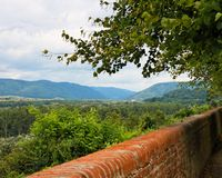 View of green valley over the brick wall Royalty Free Stock Photography