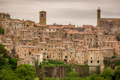 View of a green valley in Sorano over red roofs Stock Images