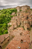View of a green valley in Sorano over red roofs. Italy Royalty Free Stock Photos