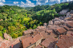 View of a green valley in Sorano over red roofs Stock Photography