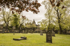 A view from Greyfriars Kirkyard. In spring, Edinburgh, Scotland, with George Heriots School in the background Royalty Free Stock Photo