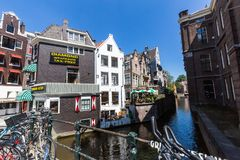 View of the Grimburgwal Canal and a Jeweler Diamond shop. AMSTERDAM, NETHERLANDS - MAY 27, 2017: View of the Grimburgwal Canal and a Jeweler Diamond shop on May Royalty Free Stock Photo