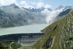 View of the Grimsel lake dam and the Oberaare glacier Royalty Free Stock Image