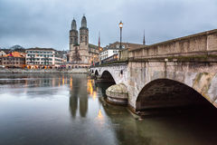 View on Grossmunster Church and Zurich Downtown in the Evening Royalty Free Stock Images