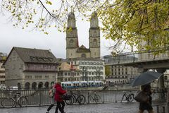 View of Grossmunster and Zurich old town from Limmat river stock images