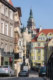 View from Grottgera Street to the old historic tenements and the preserved medieval tower town hall Stock Photos