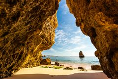 View from a grotto on Praia do Camilo in the morning, Algarve, P. View from a grotto on Praia do Camilo, Algarve, Portugal Stock Photos