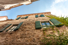 View from ground on building roofs at old narrow street Royalty Free Stock Photos