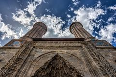 View from ground up the facade and the twin minarets of a mediev royalty free stock photography