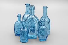 View of a group of insulated green / blue glass bottles of different sizes, which serve as decoration for interior design, the ba. View of a group of insulated royalty free stock photo