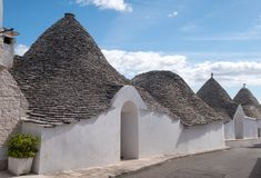 View of group of traditional trullo houses in the Aia Piccola residential area of Alberobello in the Itria Valley, Puglia Italy. View of group of traditional stock photos