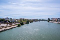 May 2019  View of Guadalquivir river in Seville, Spain. View Guadalquivir river in Seville, Spain stock images
