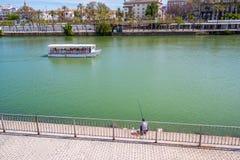 May 2019 View of Guadalquivir river in Seville, Spain. View Guadalquivir river in Seville, Spain stock photos